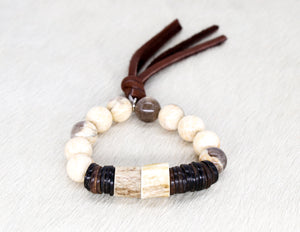 Zebradortie with coconut shell and tassel