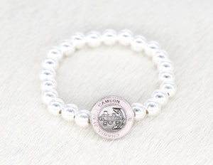 Sterling silver beads with a repurposed designer pink anchor button bracelet