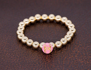 14kg beads with a repurposed designer pink button bracelet