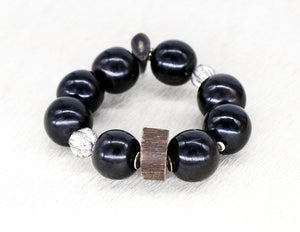 Black large bead bracelet with carved silver