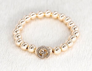 14k gold beads with a repurposed designer G bee button bracelet
