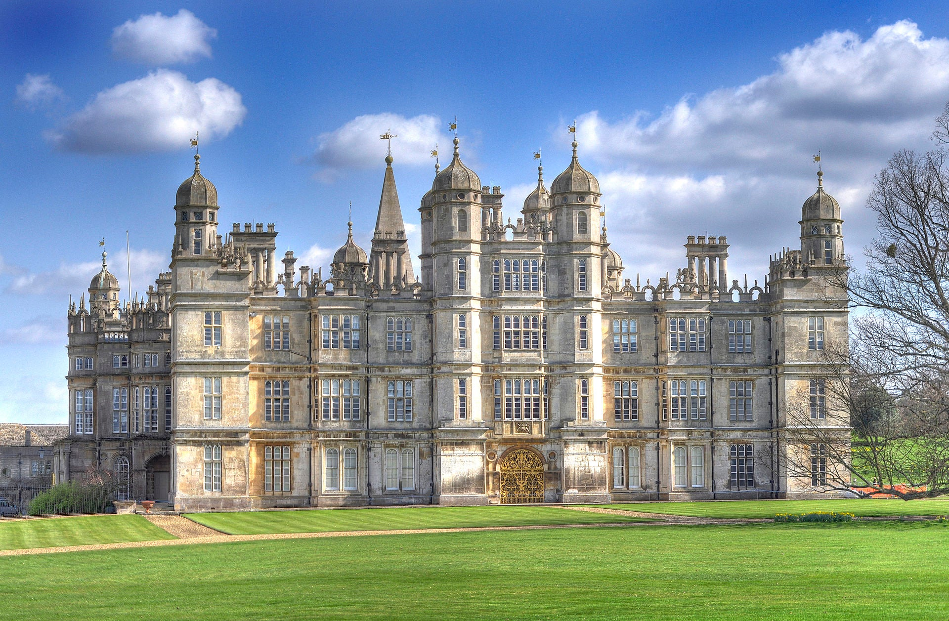 1920px-Front_of_Burghley_House_2009