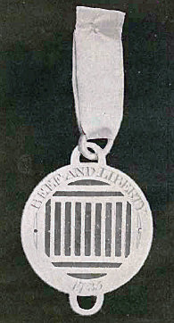 "Badge of the Sublime Society: a gridiron and the motto ""Beef and Liberty""."
