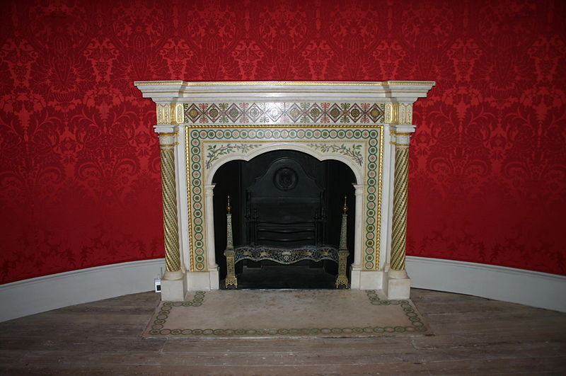 The Robert Adam fireplace in the round room.
