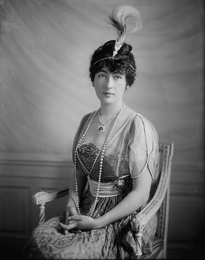 "Evalyn Walsh McClean wears a reset version of the Hope Diamond in this photograph ""with the diamond mounted as a headpiece on a three-tiered circlet of large white diamonds"" -Smithsonian (Photo: Harris & Ewing Collection, Library of Congress)"