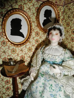 This Jane Austen doll was created by Theresa Thomson of Costume Cavalcade Dolls. She carries a full range of historically accurate 1/12 figures in her shop.