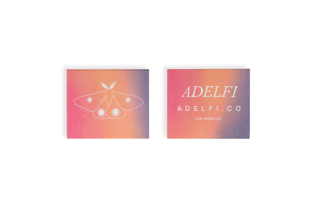 Adelfi matchbox front moth and back logo