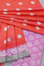 Orange banarasi with pink lotus border