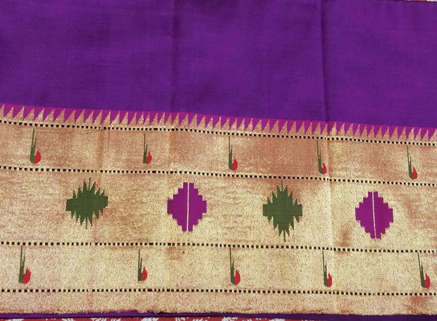 Purple blouse piece with geometrical border