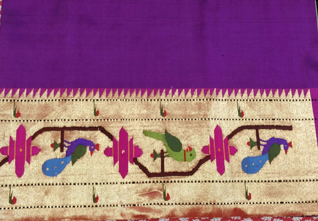 Purple blouse piece with parrot and peacock border design