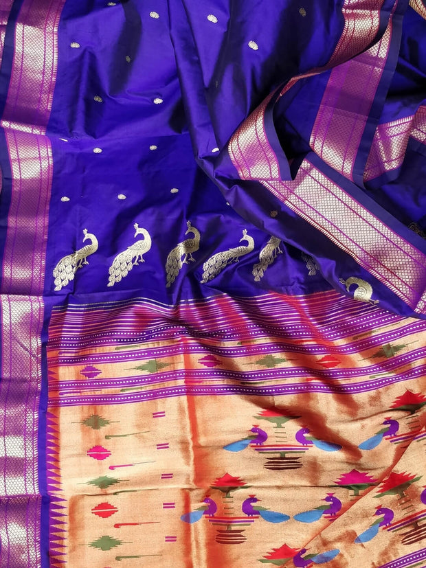 Blue single color silk paithani with silver zari border