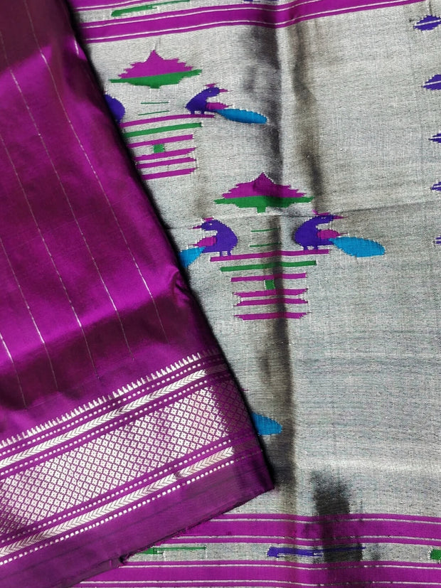Magenta single color silk paithani with silver zari border