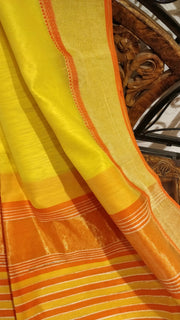 Yellow maheshwari saree with tissue border
