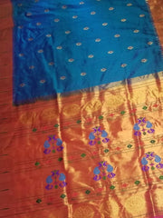 Blue muniya border paithani with peacock butti