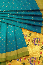 Turquoise silk paithani with pale green border