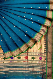 Peacock blue rich pallu paithani with green border