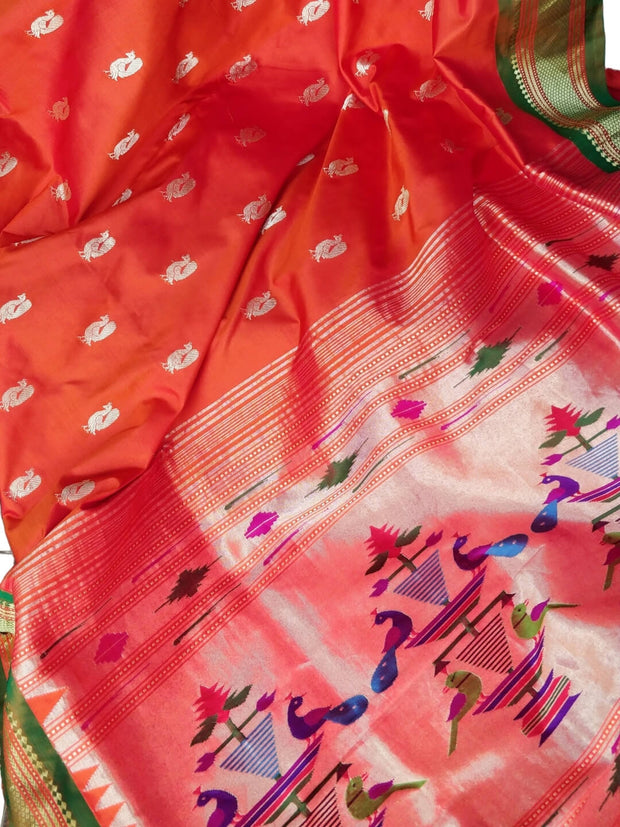 Orange rich pallu silk paithani with green border