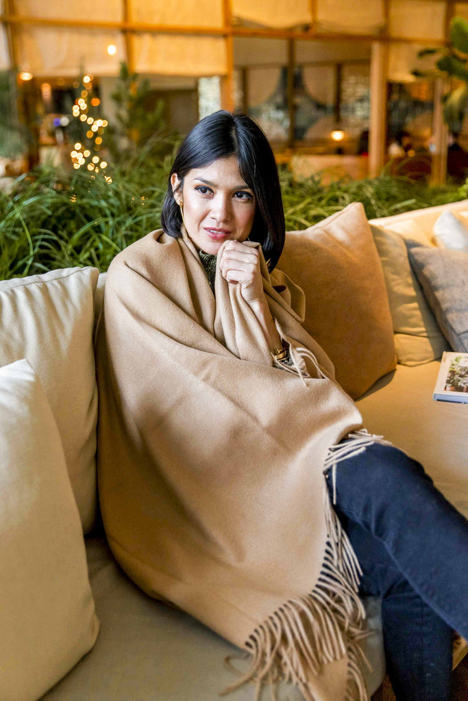 Woman wearing Cashmere Scarf with Fringe (Camel)
