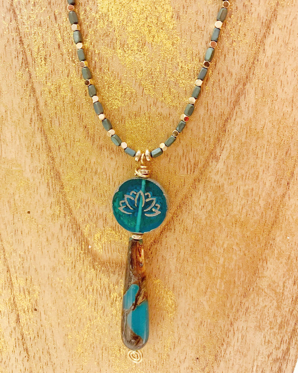 Gold and Teal Hematite Lotus Necklace