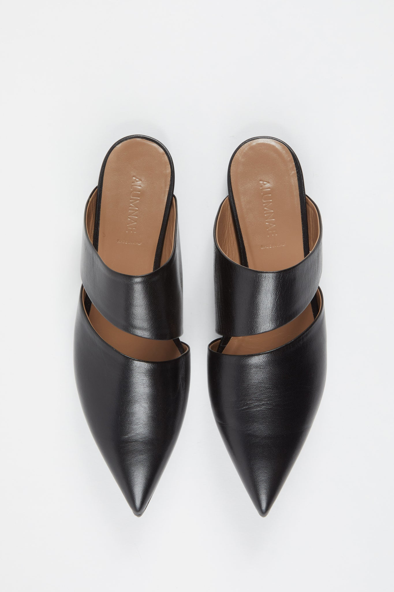 "Flat Point Toe ""Slashed"" Mule Black Nappa."