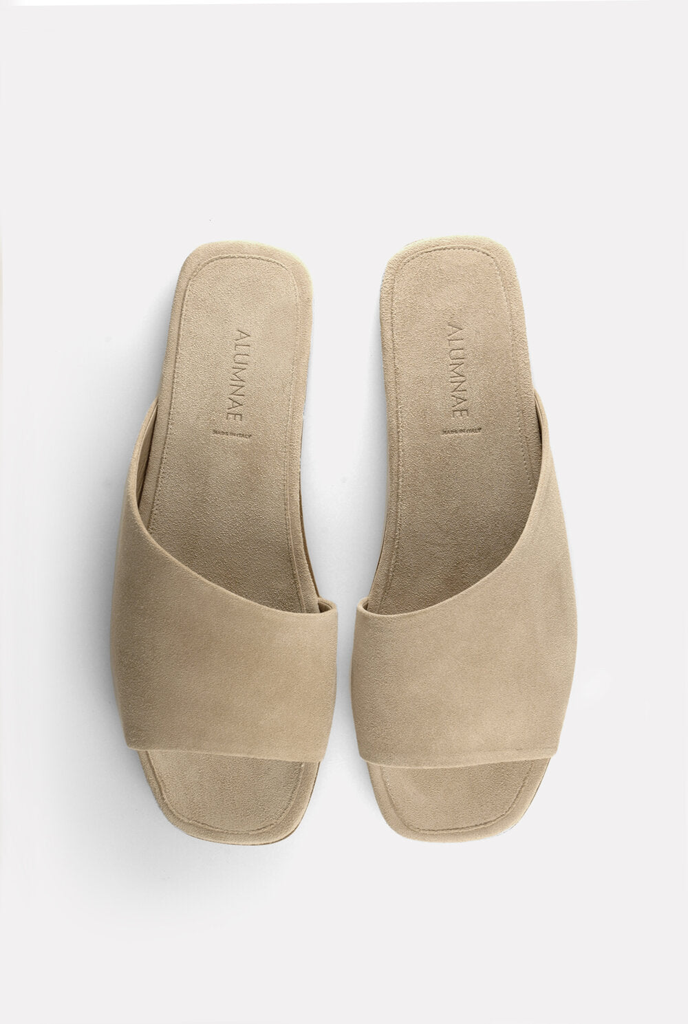 Asymmetrical Curved Slide Sand Suede.