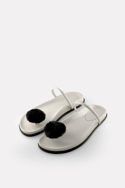Button Thong on Footbed Chalk White with Black Button.