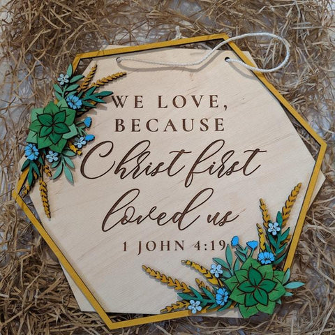Christ first loved us wooden wall sign