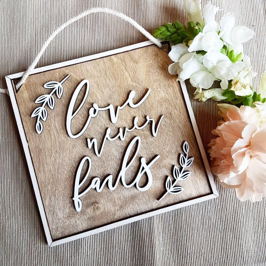 Love never fails wooden wall plaque