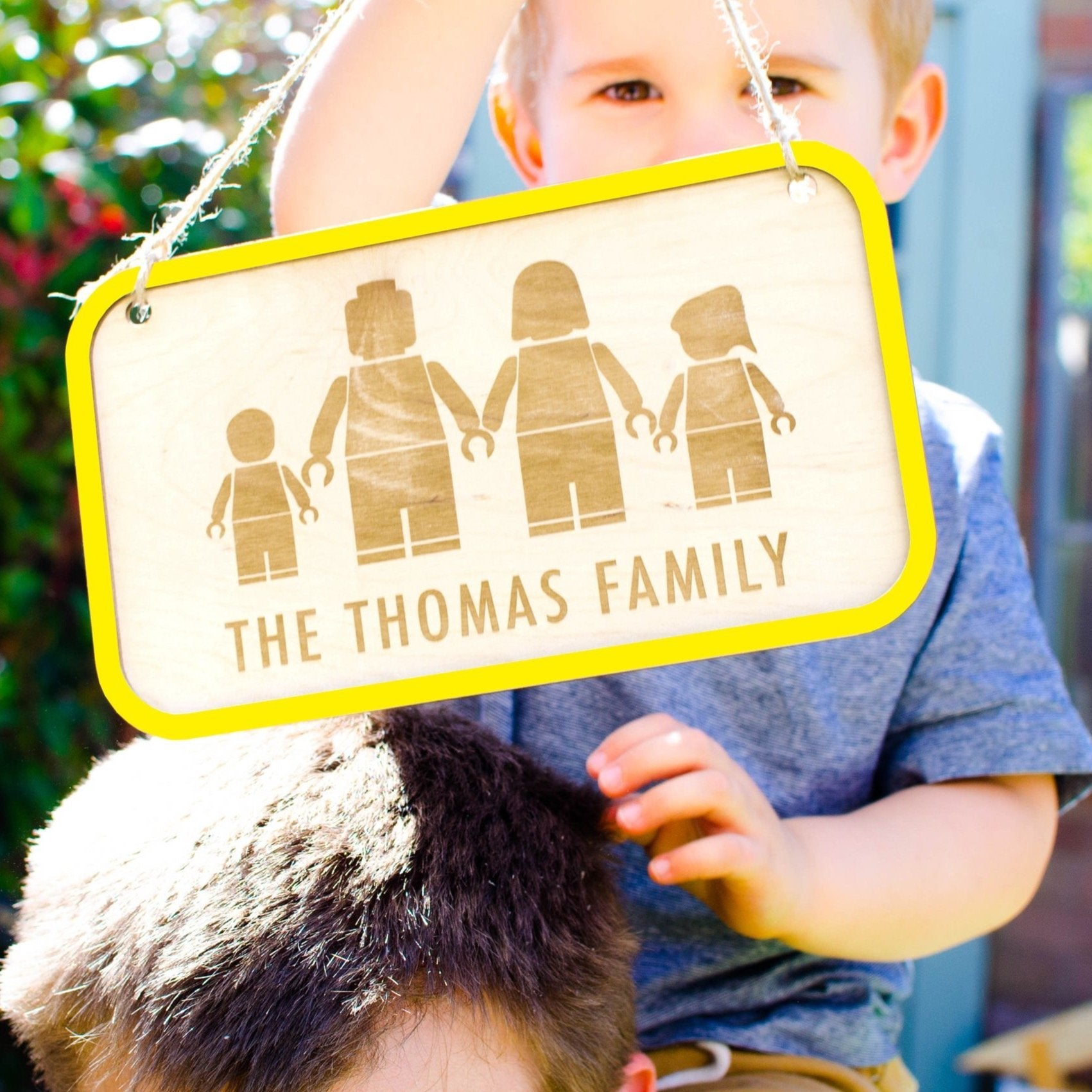 Yellow Lego family wall hanging sign