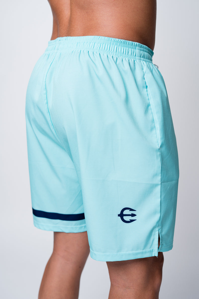Mens neptune athletics seafoam green shorts with navy trident on back right leg