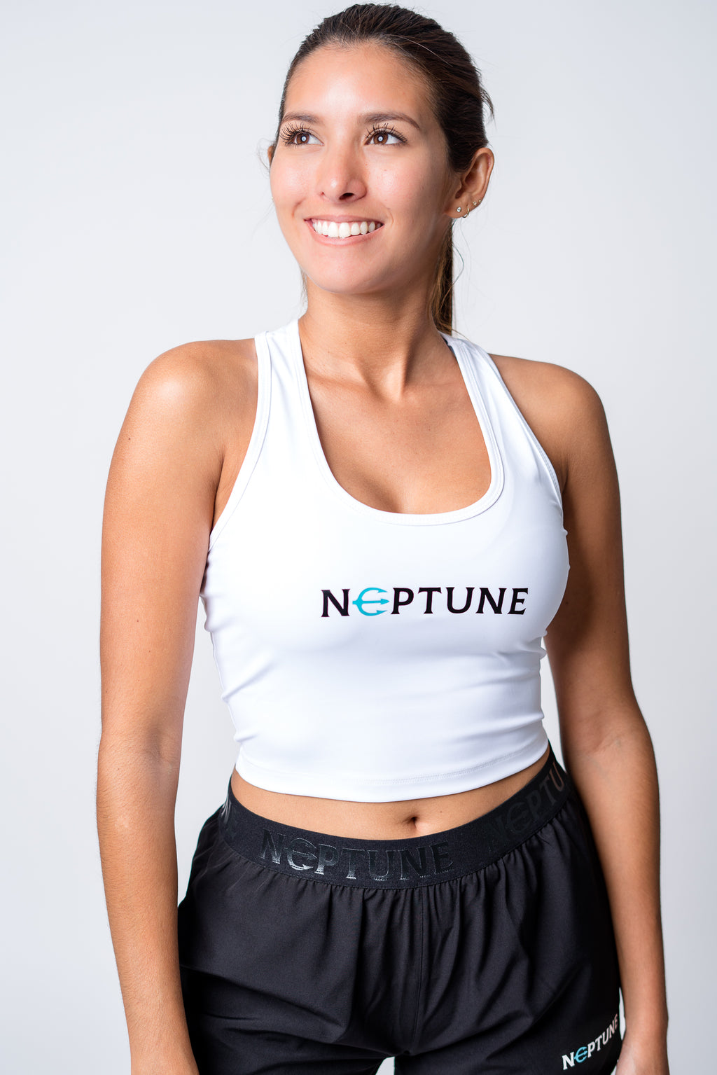 Womens white crop top with neptune logo on center