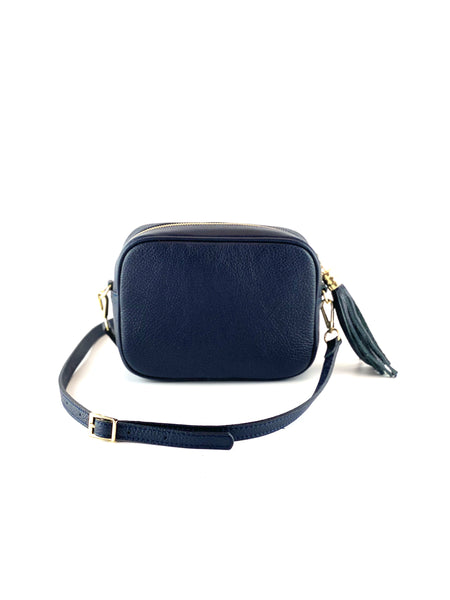 An image of a small navy blue leather messenger bag with a leather tassel on the zip which opens across the top of the bag.