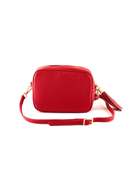 An image of a small red leather messenger bag with a leather tassel on the zip which opens across the top of the bag.