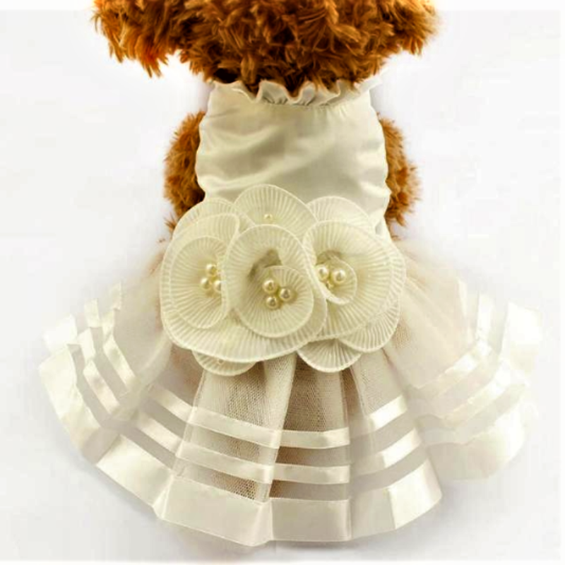 A Dog Wearing A White Satin Pearl Flower Dog Dress