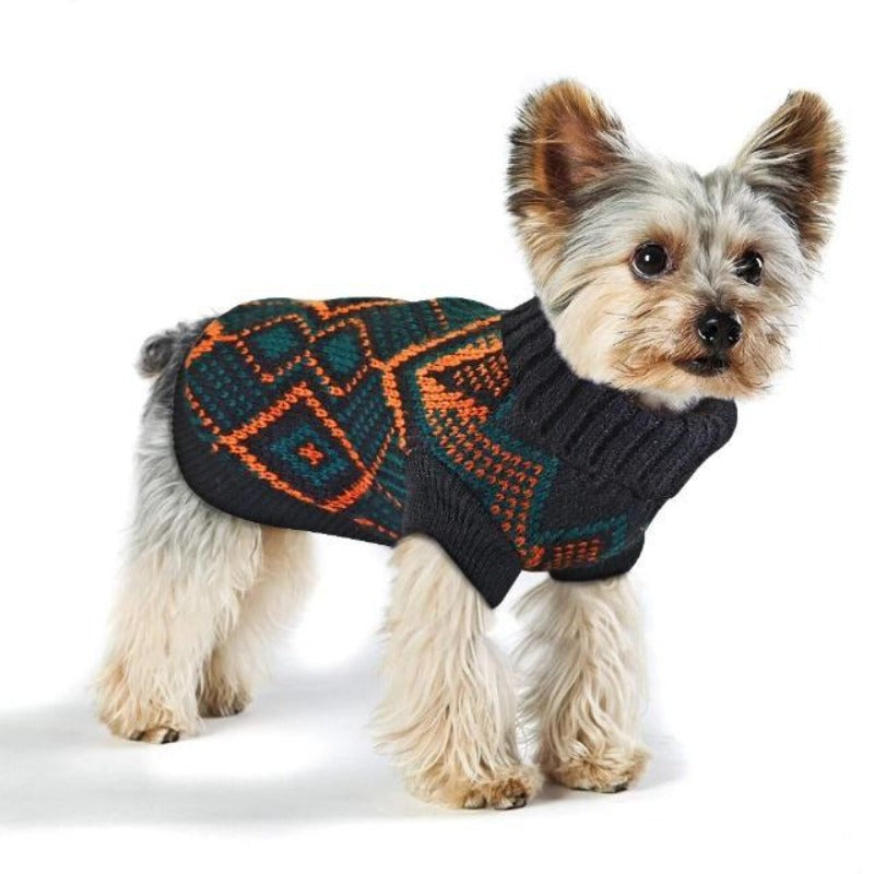 Dog wearing a Toggy Doggy stretchy dog sweater that has a pretty patterned design of bluish-black and orange alternately.