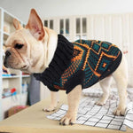 Load image into Gallery viewer, Dog wearing a Toggy Doggy stretchy dog sweater that has a pretty patterned design of bluish-black and orange alternately.