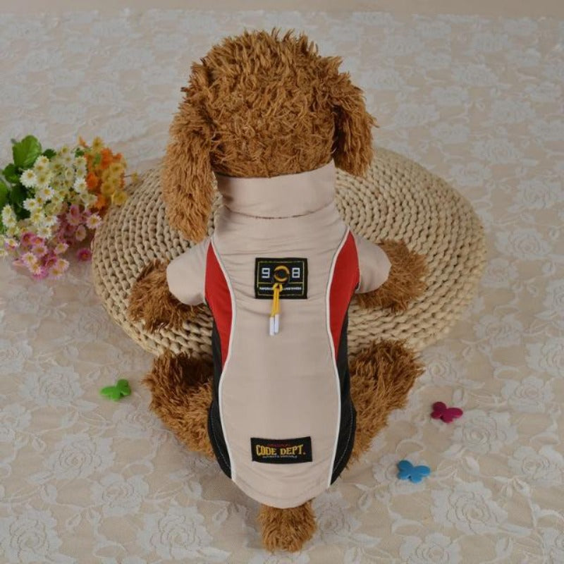 A Dog Wearing A Beige All Weather Dog Vest