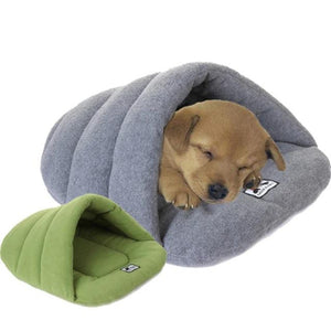 A Puppy Sleeping In The Gray Slipper Dog Sleeping Bag