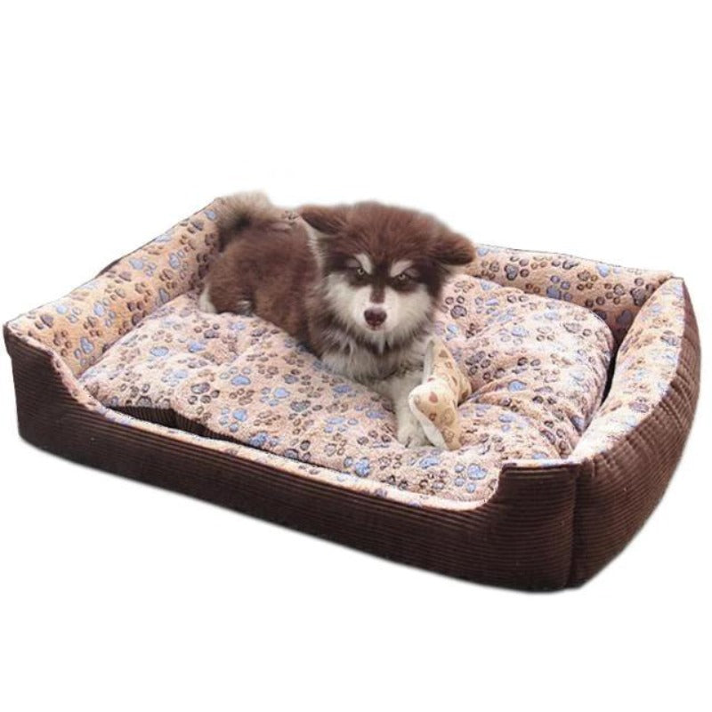 A Dog Sitting On A Coffee Colored Fleece Doggy Bed