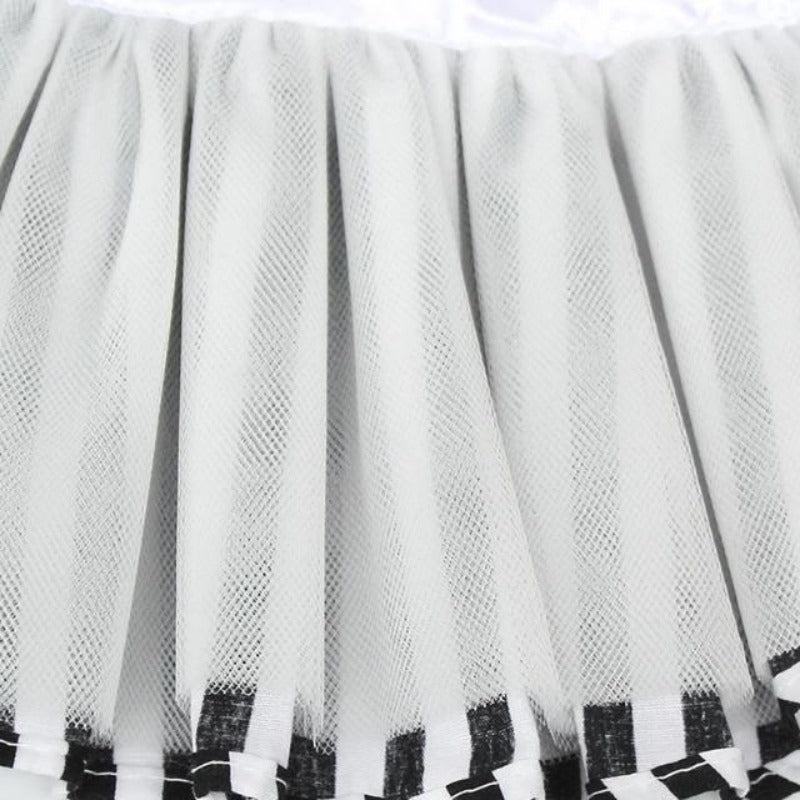 The Tulle Lining Of The Black And White Striped Dog Dress