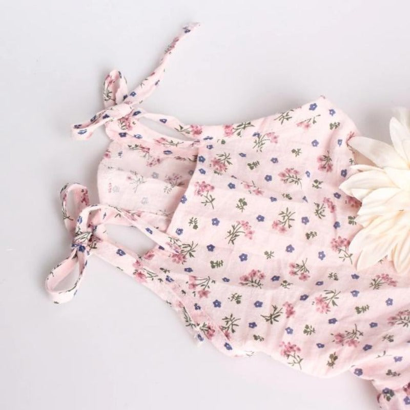 The halter straps of the Beige Big Flower Dress showing the beautiful floral design of the fabric