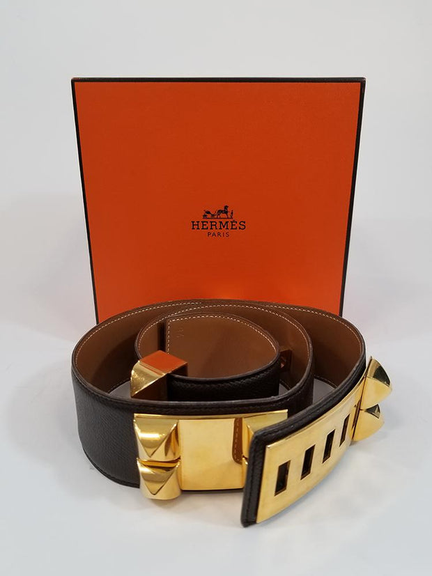 Hermès Collier de Chien dark brown calf leather belt with gold-plated rhodium metal hardware. This belt measures 34 inches in length, has five notches for a slight adjustment in the overall fit and features oversized studs. This item comes with its original box. Revolve Boston Consignment.