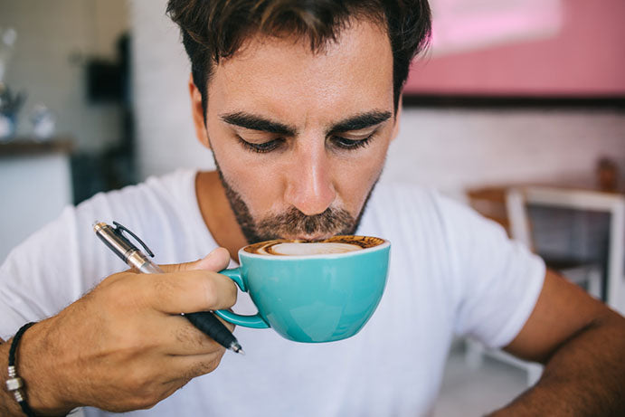man sipping coffee from mug
