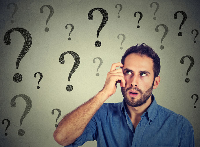 thoughtful man with question marks
