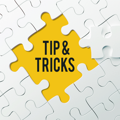 white jigsaw puzzel with the centre piec in bright yellow and the words tips and tricks printed on it.