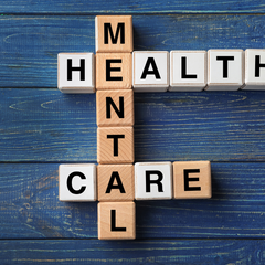 Scrabble type letters showing the words Mental health care interlinked like a crossword.