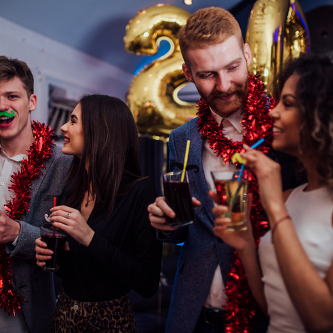 People celebrating Christmas with drinks in their hands