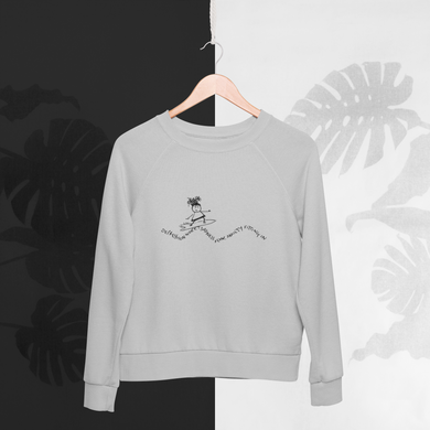 grey sweatshirt with the cartoon inspired by the quote from Jon Kabat Zinn - You can't beat the waves but you can learn to surf - mental wellbeing
