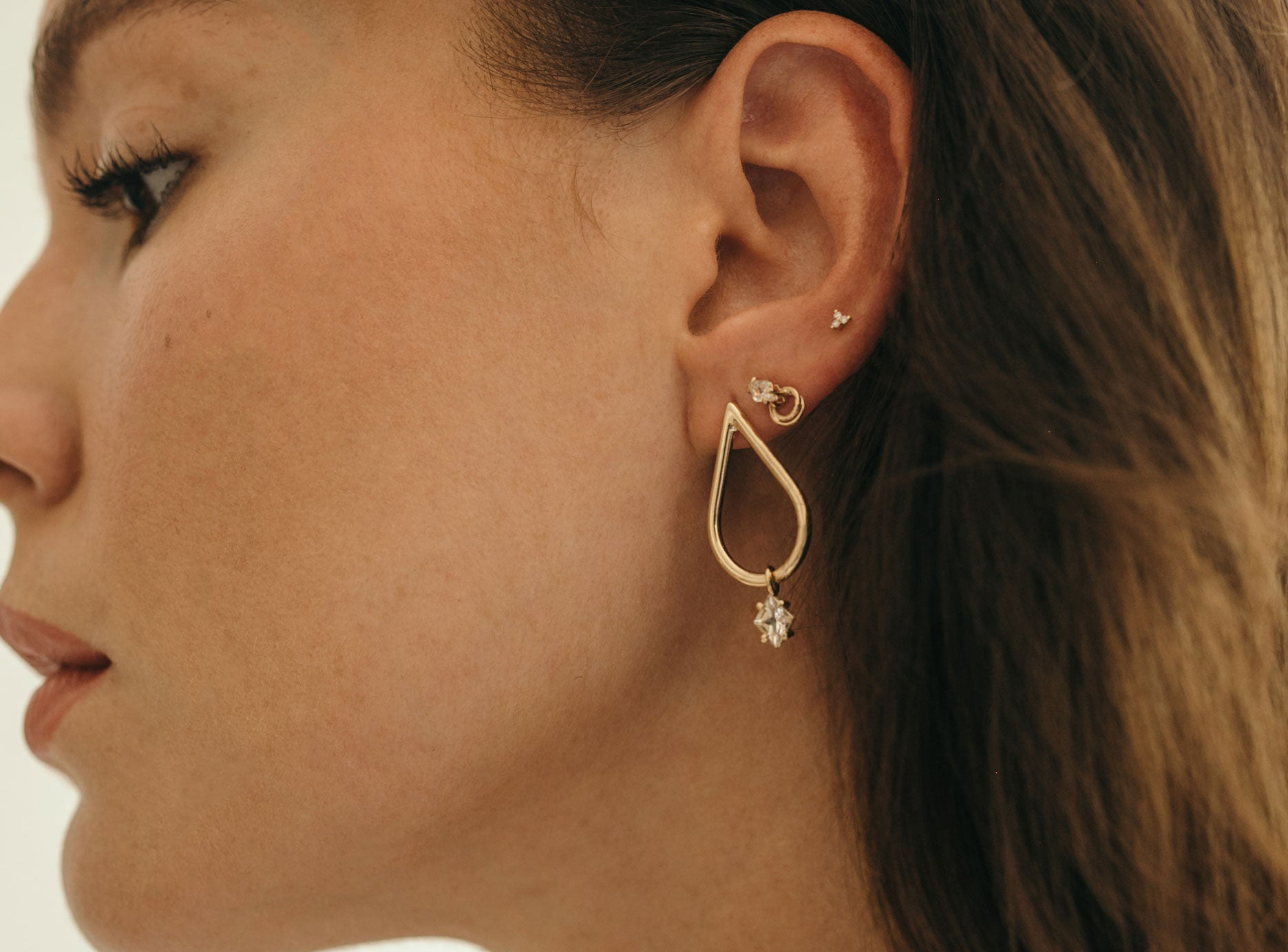 Ally wears (from left to right): Dena Sunstone Earrings, Nuna Stone Studs and Kalani Studs.