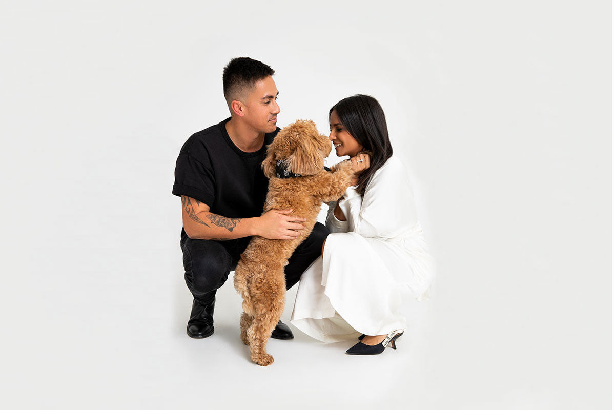 A photo of Reeve, Michele and their brown dog laughing together